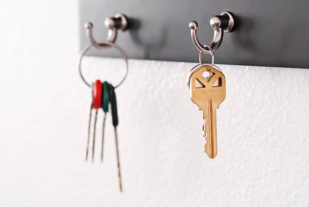 house keys on wall mounted key rack