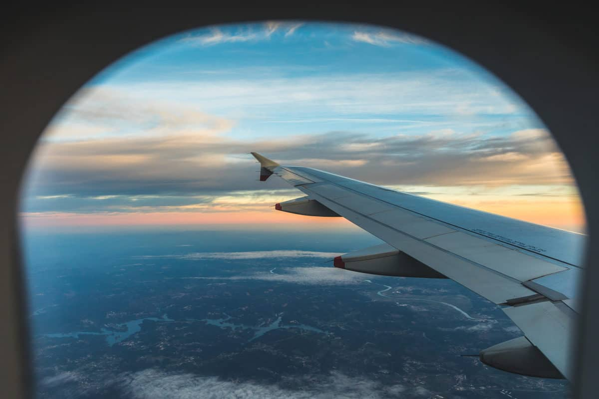 view outside airplane window of left wing